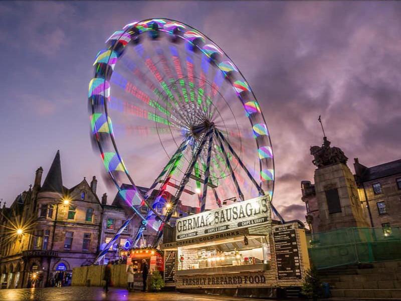 Festival wheel against a dusk sky